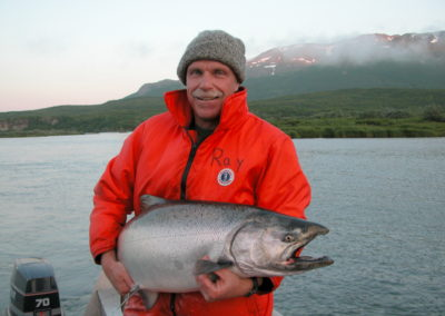 Scientist with Chinook salmon in Chignik, Alaska | Daniel Schindler